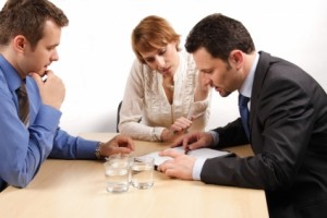 Couple discussing divorce mediation options with a divorce lawyer